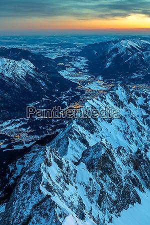 daybreak on zugspitze mountain summit with