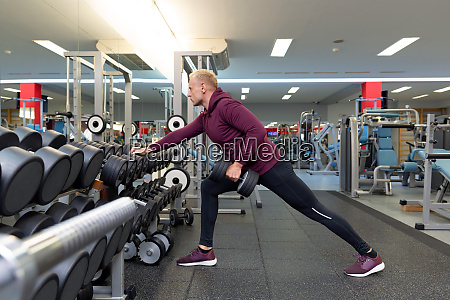 young man doing the exercises with