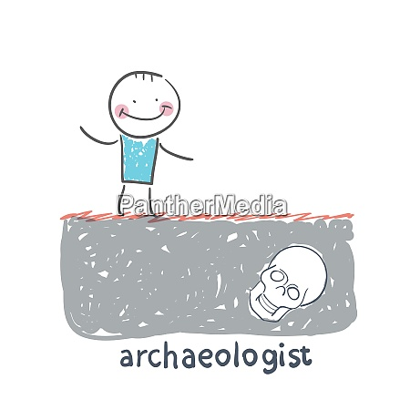 archaeologist stands on the site where
