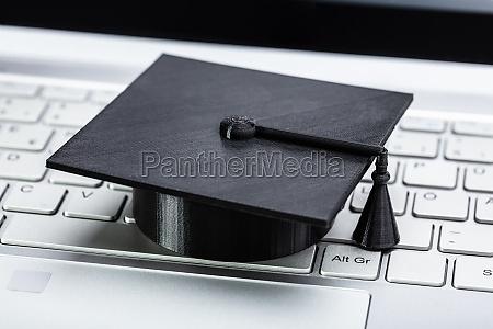 black graduation hat on keyboard