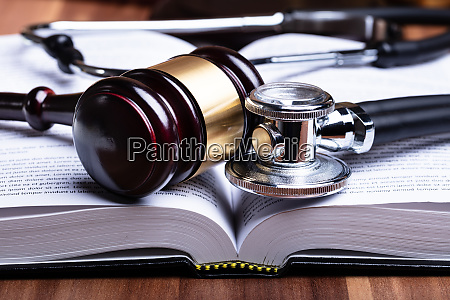 stethoscope and mallet over opened law