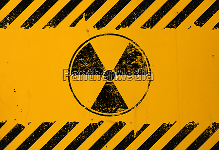 black radioactive sign over yellow background
