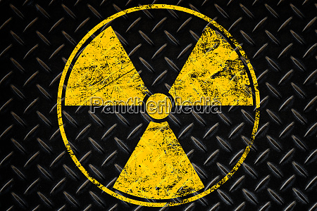 yellow radioactive sign over black background