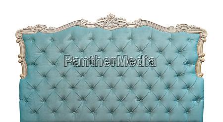 blue velvet bed headboard isolated on