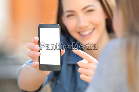 woman showing a blank smart phone