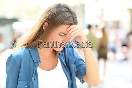 girl suffering headache standing in the
