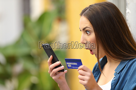 amazed woman finding surprising offers buying