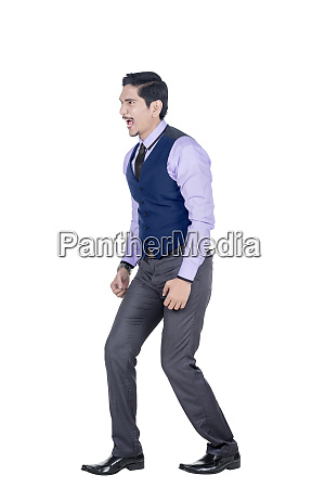 expressive asian businessman in formal suit