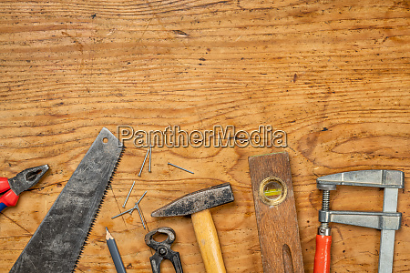 woodworking tools on a wooden background