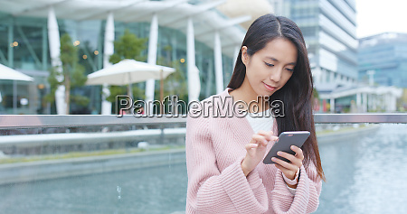 woman look at smart phone