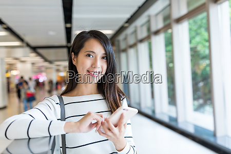 woman holding with mobile phone