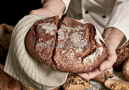 hot loaf of rye bread in