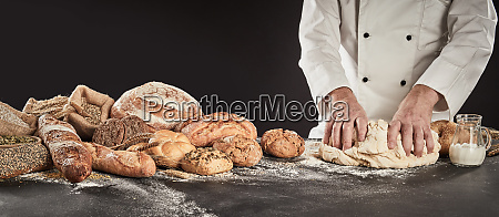 baker kneading a large mound of