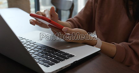 woman type on laptop computer and