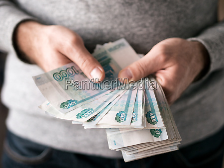 hands counting rubles