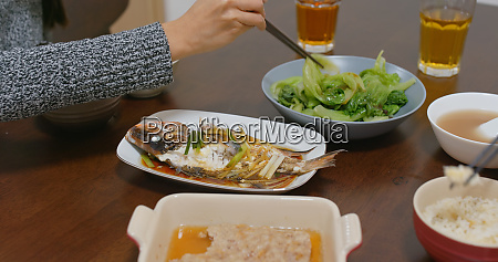 couple eat dinner together at home