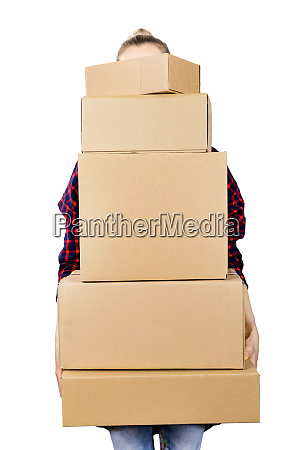 woman carrying stack of cardboard boxes