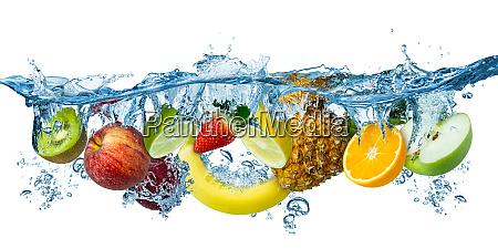 fresh multi fruits splashing into blue