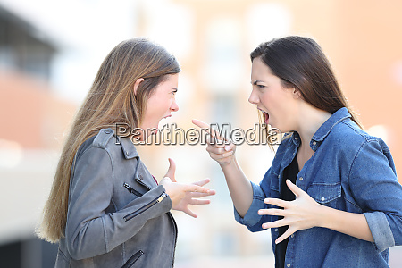 two women fighting shouting each other