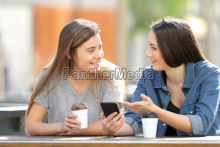 friends talking about phone content in