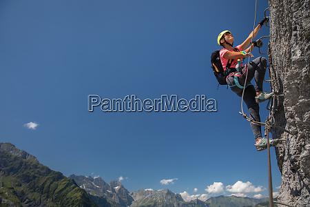 pretty female climber on a via