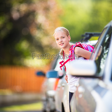 cute little girl going home from