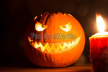 spooky smiling halloween pumpkin with burning