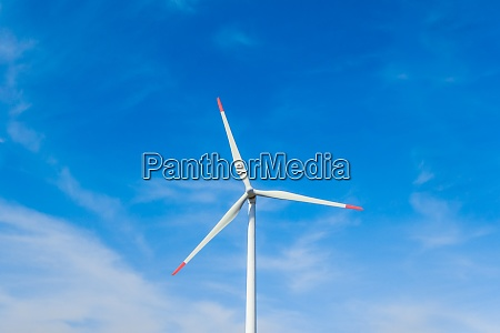rotating windmill generating renewable energy with