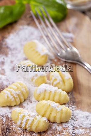 closeup of raw gnocchi on wood