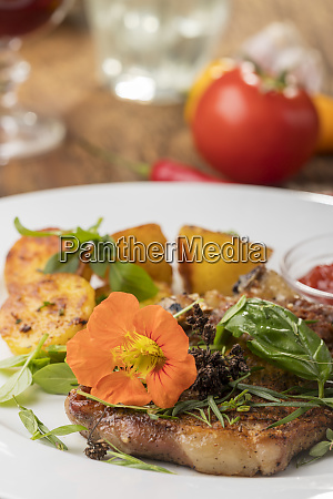 grilled veal cutlet with a nasturtium