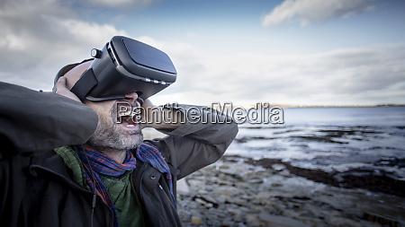 angry man playing virtual reality game