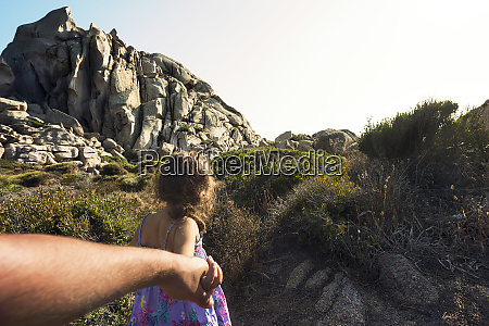 little girl walking hand in hand
