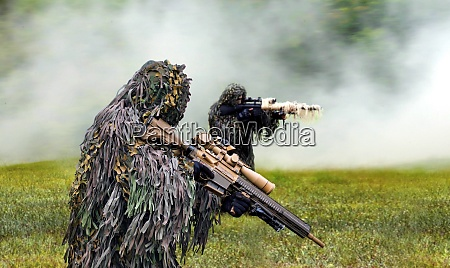 military commando dressed in ghillie camouflage