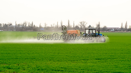 tractor with a spray device for