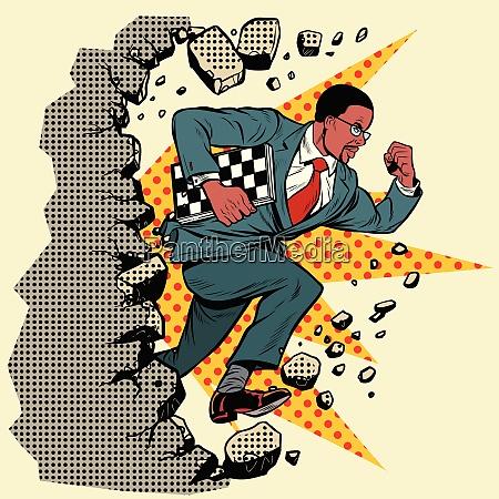 african chess grandmaster breaks a wall