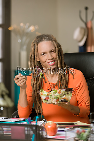 woman with drealocks eating a healthy