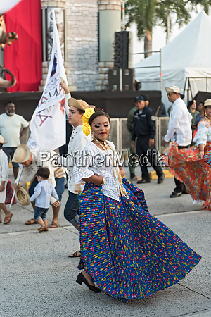 folklore dances in traditional costume at