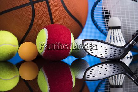 assorted sports equipment winner background