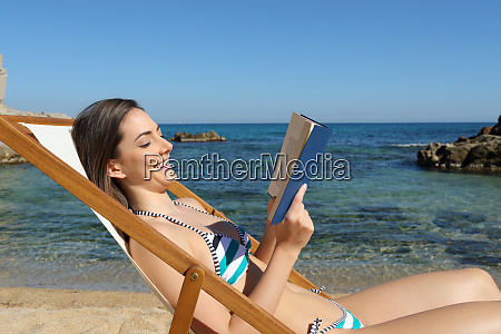 happy woman reading a book on