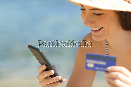 happy tourist paying online with credit