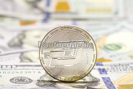 cryptocurrency displayed on dollar bills