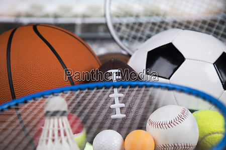 assorted sports equipment winner background