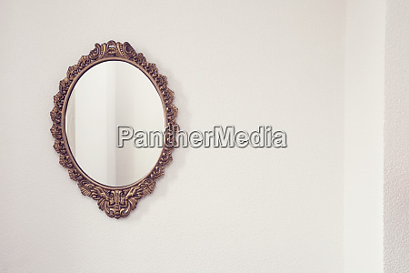golden antique mirror on white wall