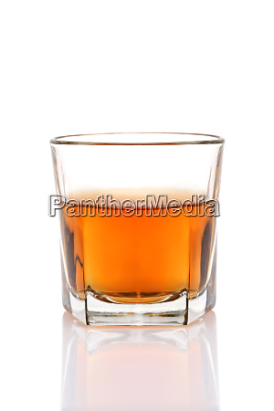 glass cup of whiskey on a