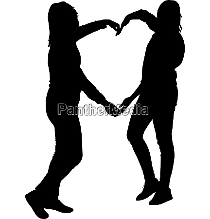 silhouette two girls holding hands in