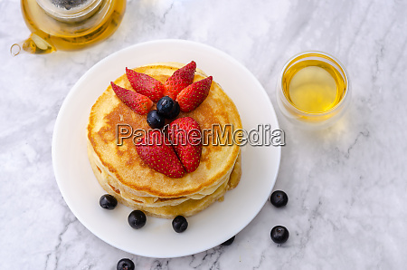 pancakes with strawberry and blueberry on