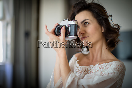 pretty young female photographer in her