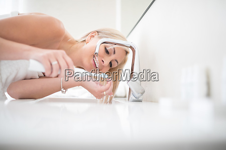 pretty middle aged woman brushing her
