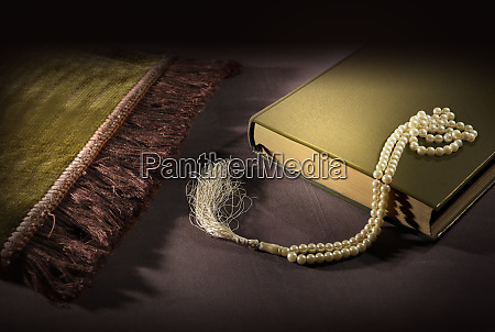 quran and prayer beads with prayer
