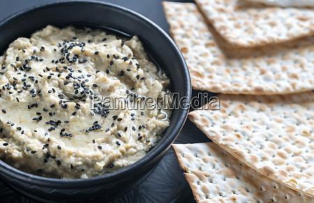 bowl of baba ghanoush with matzo